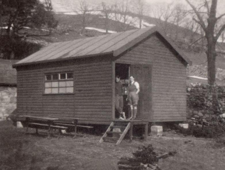 the newly built men's dormitory hut